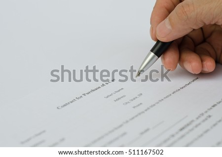 Man filling a contract for purchase of car, close up.