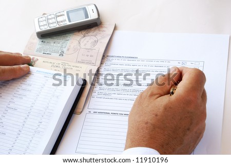 Man filling security/health clearance - stock photo