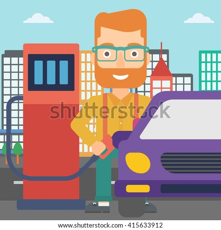 Man filling up fuel into car. - stock photo