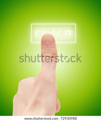 "Man finger push ""enter"" button - stock photo"