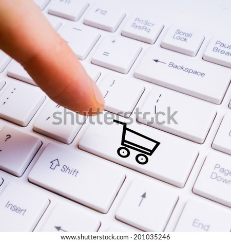 man finger pushing buy button on pc keyboard