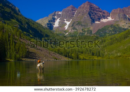 Man fishing at Maroon Bells aspen colorado rocky mountains 14er