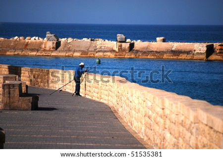 man fishing on coast of Tel Aviv