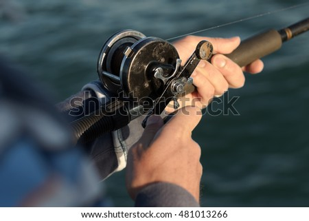 Man fishing with rod and reel