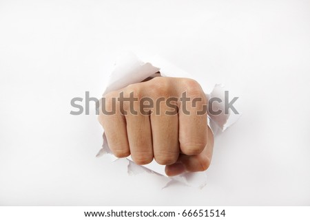Man fist break through the white paper