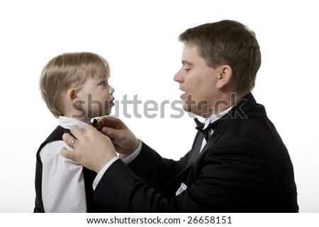 Man Fixing Boy's Bow Tie - stock photo
