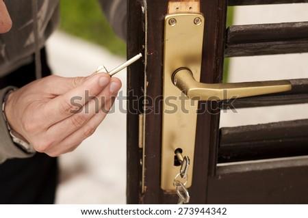 Man fixing door - stock photo