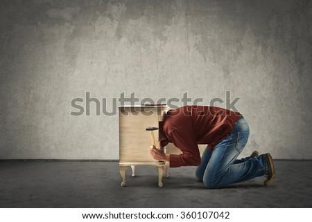 Man fixing furniture - stock photo