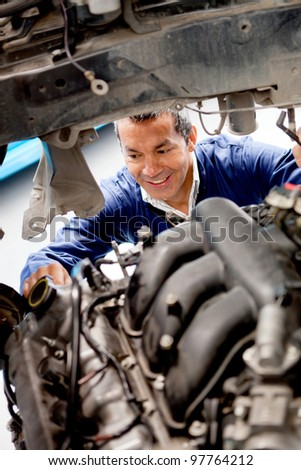 Man fixing mechanical problem on a car - stock photo