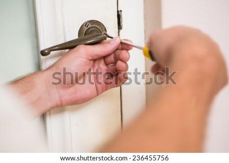 Man fixing the door handle with screwdriver in a new house & Fixing Door Stock Photos Royalty-Free Images \u0026 Vectors - Shutterstock Pezcame.Com