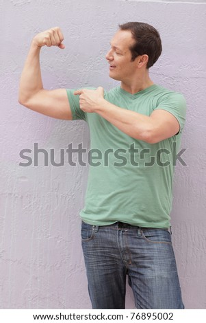 Man flexing his muscles - stock photo