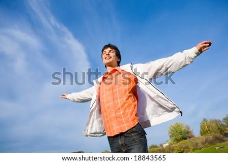 Man flies in the sky - stock photo