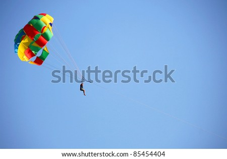 Man flies with a parachute