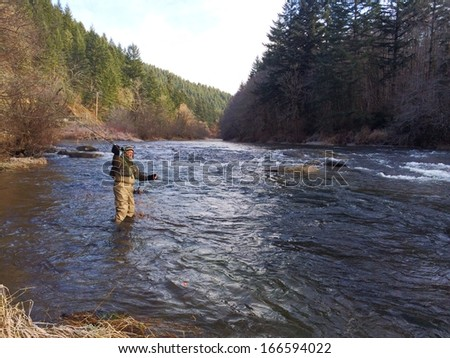 Fisherman on river stock photo 551304982 shutterstock for Fishing in cold weather