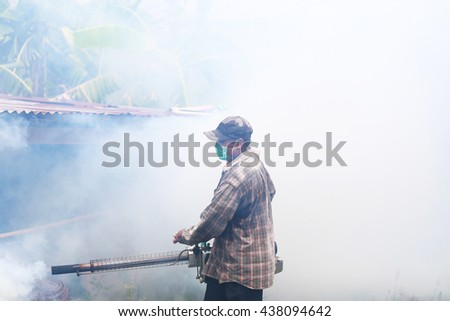 Man fogging mosquitoes,Fogging to prevent spread of dengue fever - stock photo