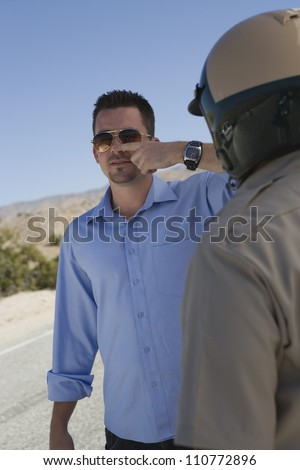 Man Forced To Take A Field Sobriety Test - stock photo