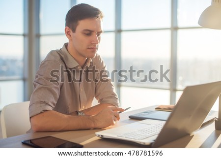 Man freelancer businessman working on laptop computer in office.