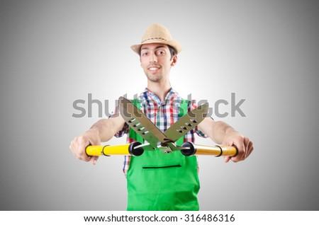 Man gardener with shears on white - stock photo