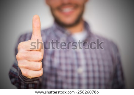 man gesturing OK sign on light background - stock photo