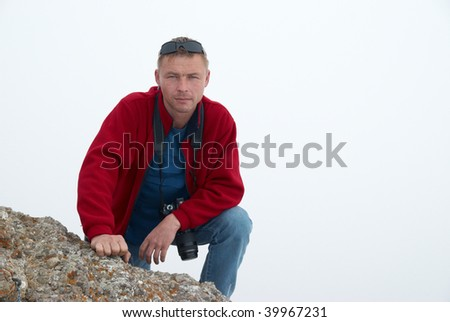 Man gesturing on the rock with white background - stock photo