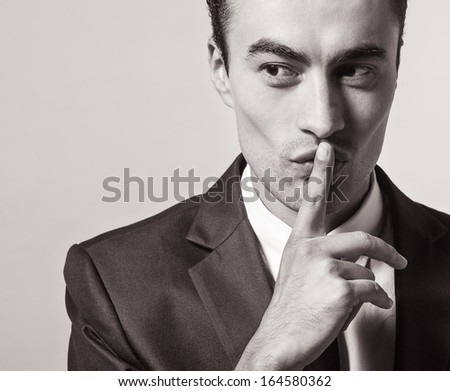 Man gesturing silent. Quiet. - stock photo
