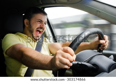Man gets in accident while driving car - stock photo