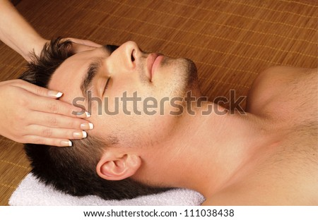 Man getting a facial / face massage at day spa