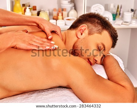 Man getting classical relaxing massage in spa. - stock photo
