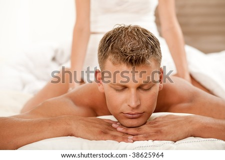Man getting massage at spa - stock photo