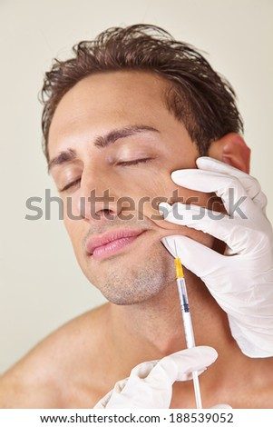 Man getting syringe with hyaluronic acid against wrinkles in the mouth area - stock photo