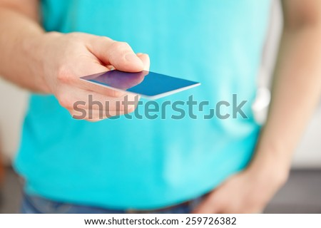 Man gives a credit card to pay - stock photo