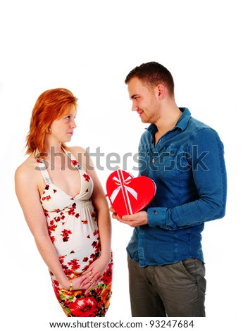 man gives woman a heart shaped box