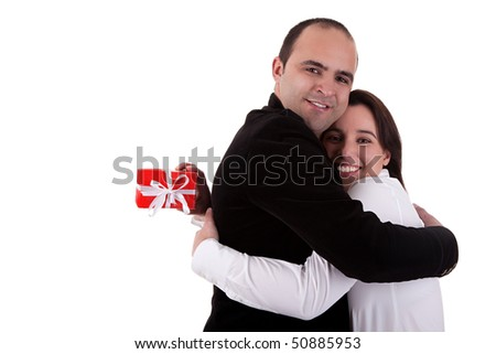 Man giving a gift to a woman, holding her, isolated on white background - stock photo