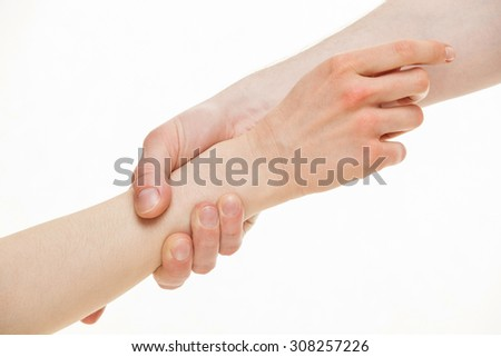 Man giving a helping hand to woman, white background - stock photo