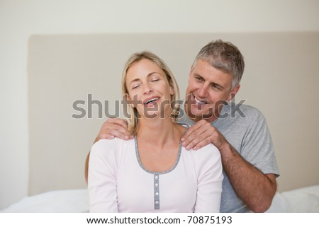 Man giving a massage to his wife - stock photo