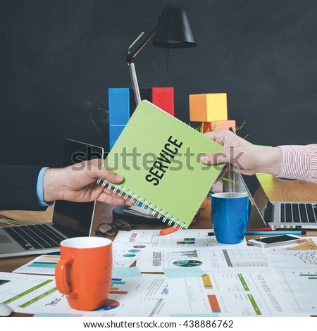 Man giving book which written Service - stock photo