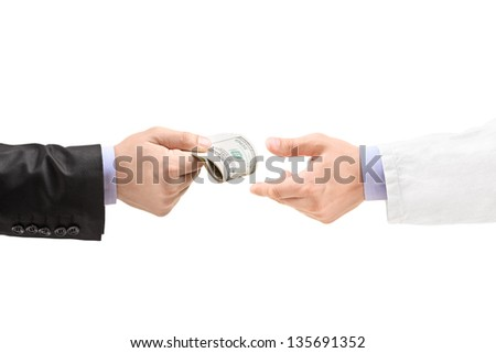 Man giving bribe to a doctor, isolated on white background - stock photo
