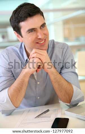 Man giving interview to job applicant - stock photo
