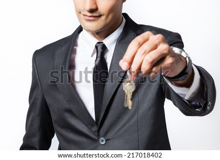 Man giving keys - stock photo