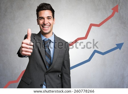 Man giving thumbs up in front of a positive diagram - stock photo