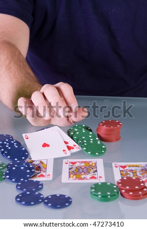 Man goes all in with royal flush pushing his chips for bet