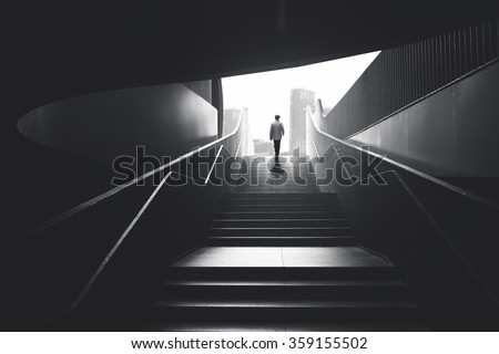 man going from underground to the city - stock photo
