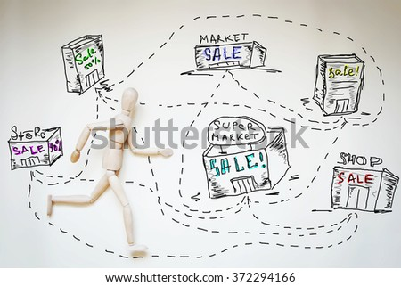 Man going shopping in many stores. Abstract image with a wooden puppet - stock photo