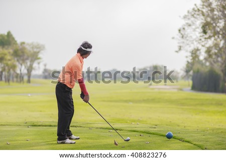 Man golfer hitting a driver from the tee-box. - stock photo