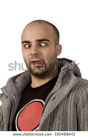 man grimacing with the tongue out and crooked eyes on white background - stock photo