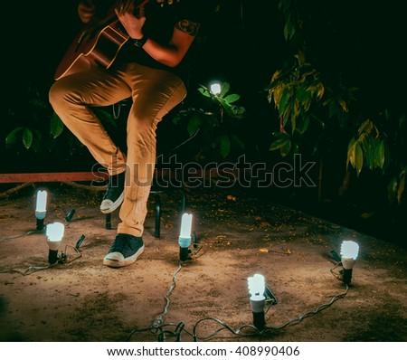 man - guitar - Night - light - stock photo