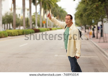 Man hailing a cab - stock photo