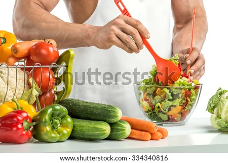 man hand cook make mix vegetables salad on kitchen, closeup photo - stock photo