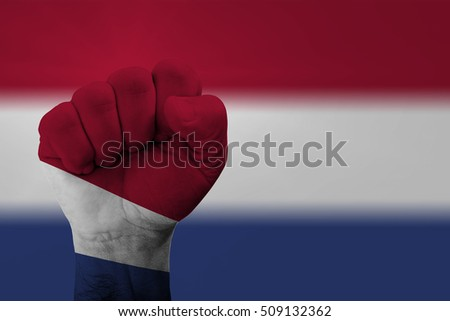 Man hand fist of NETHERLANDS flag painted