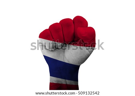 Man hand fist of THAILAND flag painted